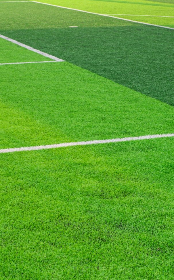 Soccer field grass conner.pattern of fresh green grass for football